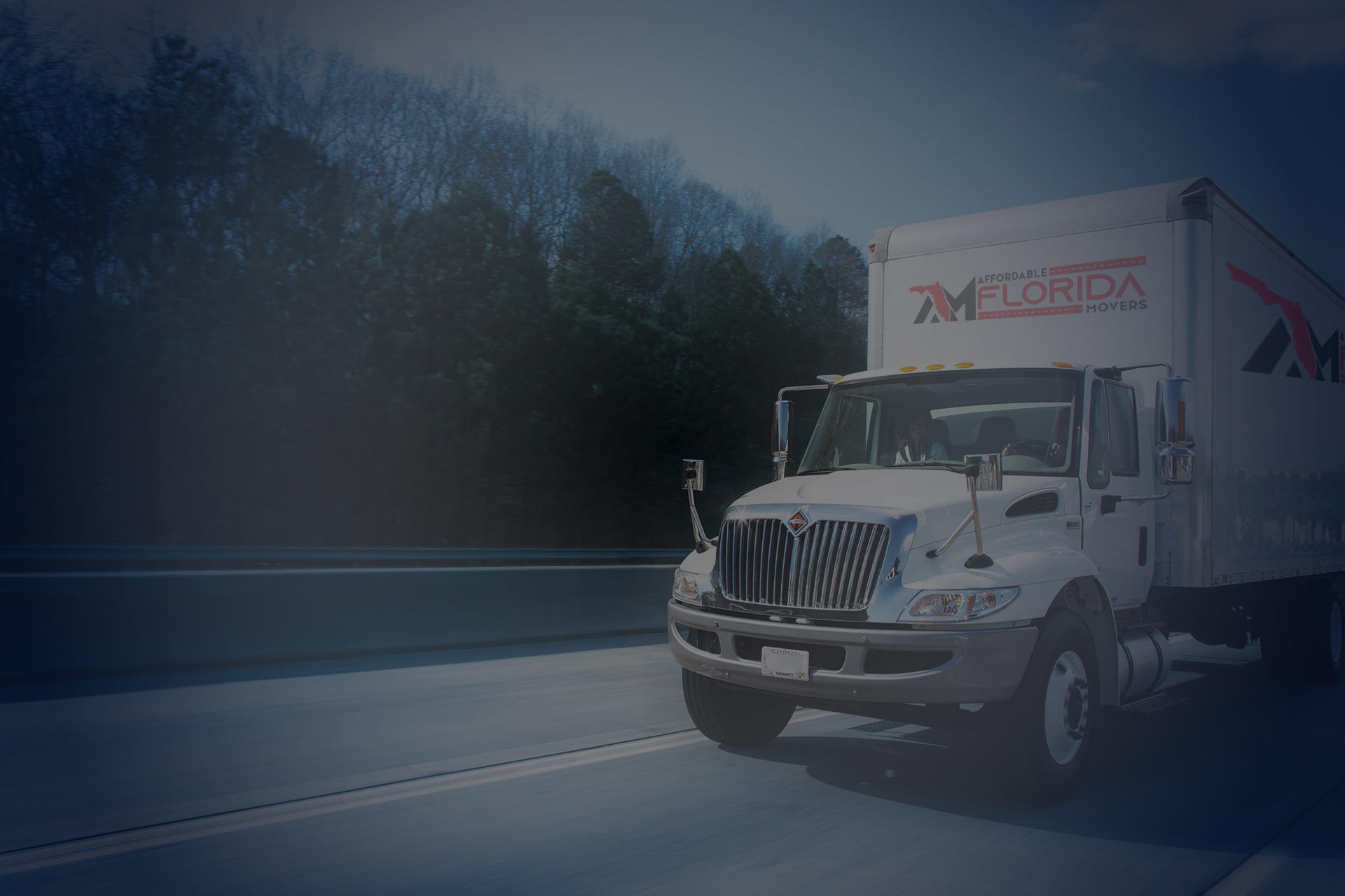 dark image of moving truck from Affordable Florida Movers driving on a highway