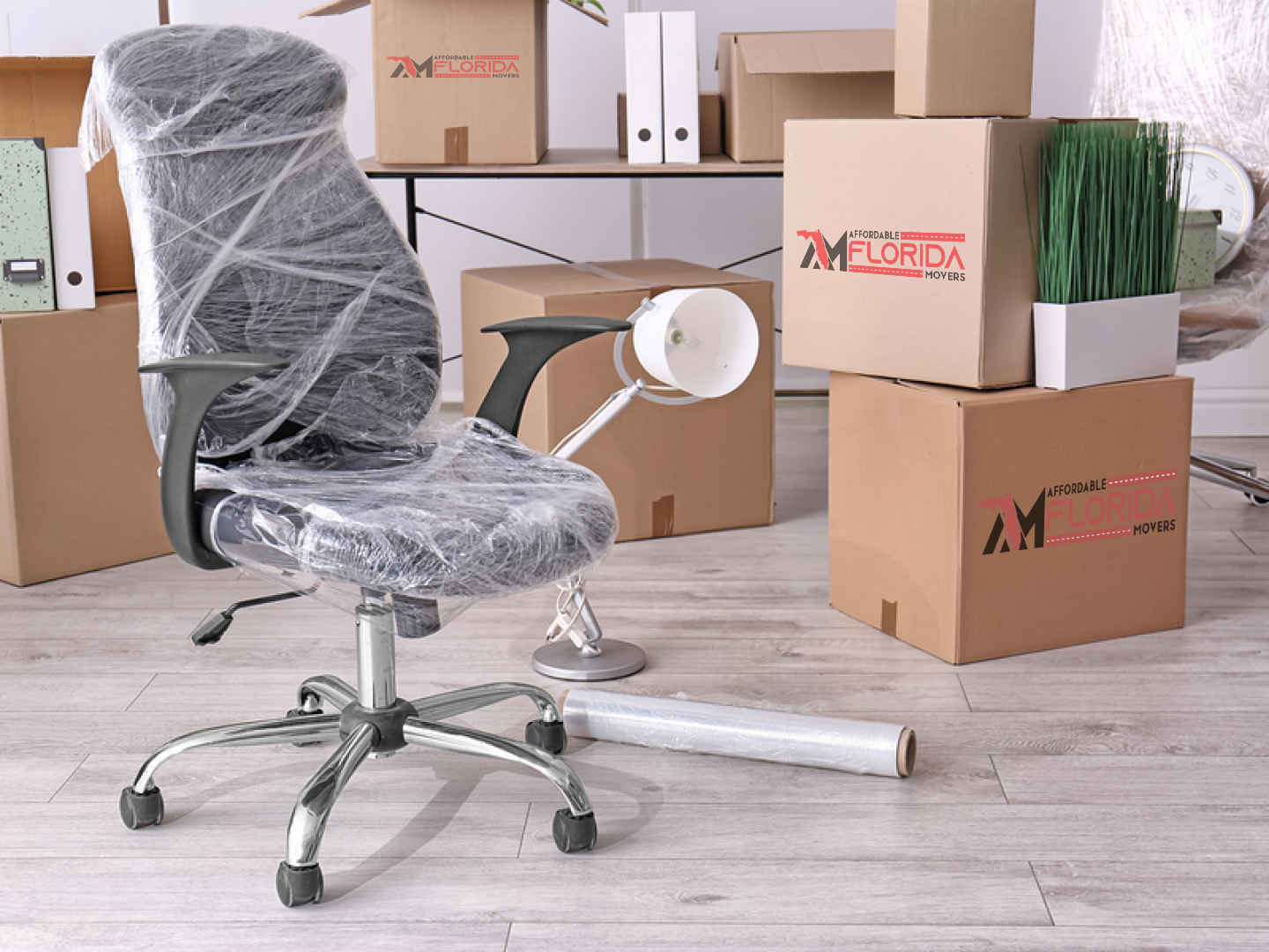 office chair wrapped in plastic surrounded by moving boxes