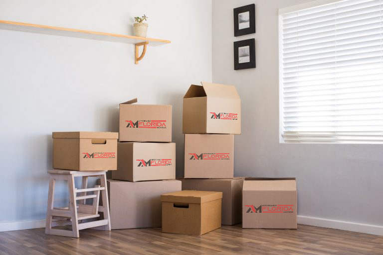moving boxes and furniture in corner of room